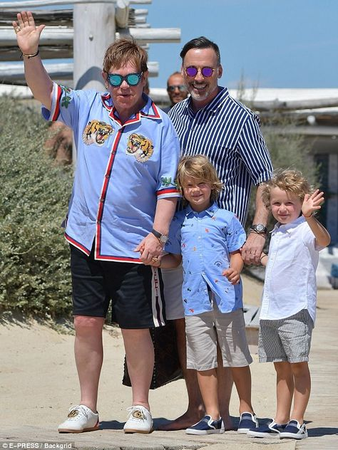 Sun-drenched: Sir Elton John, 70, and his partner David Furnish, 54, have whisked their two sons Zachary, six, and Elijah, four, to St Tropez