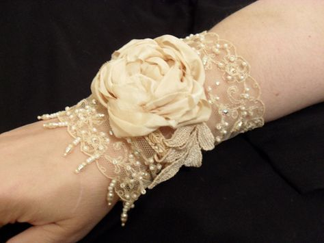 A romantic lace cuff with a fabric cabbage rose.