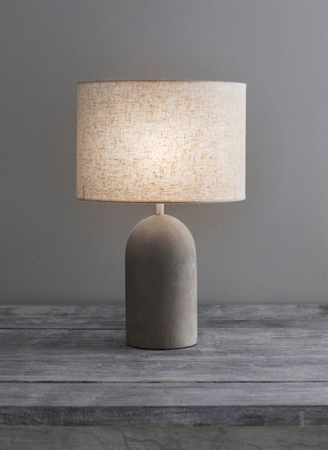 Illuminate your home with this Millbank bullet table lamp from Garden Trading. Topped with a pale grey lamp shade in a classic drum shape, this table lamp is perfect for accenting a room and highlight Table Beton, Cement Table, Concrete Lamp, Concrete Garden, Lampe Decoration, Table Decorations, Diy Luminaire, Unique Table Lamps, Rustic Table Lamps