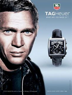 In the movie, Steve McQueen's character Michael Delaney, driving his Porsche 917 Gulf, wears a TAG Heuer Monaco with a blue face. Description from watches.infoniac.com. I searched for this on bing.com/images