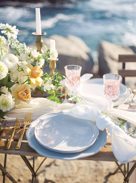 Is there anything more romantic than this gorgeous sweetheart table by the ocean for two. Flowing silk table runner, lush, organic floral arrangement and growing install just to give it that little extra. Floral arrangements by San Diego wedding florist Le Champagne Projects.