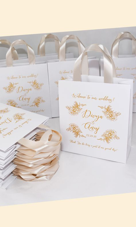Chic Wedding Welcome bags with Champagne satin ribbon handles, Gold roses and custom print. Personalized Wedding gifts and favors for guests. #weddingbags #weddingwelcomebags #welcomebags #bagsforguests #weddingwelcome #weddingfavor #giftbags #partyfavor #weddingfavor #weddingfavors #weddingfavour #personalizedgift #weddingwelcome #weddingparty #weddingdecor #elegantwedding #thankyoutag #destinationwedding #welcomeletter #goldwedding #champagnewedding