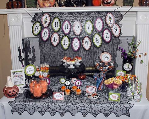 Fun Halloween party dessert table, banner and backdrop!  See more party planning ideas at CatchMyParty.com!