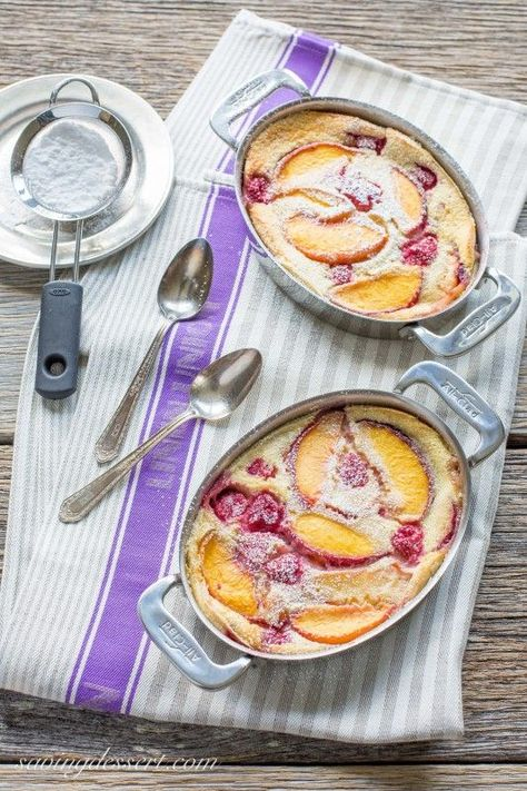 Fresh Peach & Raspberry Clafoutis Raspberry Peach Clafoutis (pronounced klafuti) is a traditional French dessert made with seasonal fresh fruit, covered in a thick custard-like batter, then baked. It is often served warm with a dusting of confectioners' s Desserts Français, Dessert Recipes, Plated Desserts, Traditional French Desserts, Small Baking Dish, Fresh Fruit, Sweet Recipes, Confectioners Sugar, Food Porn