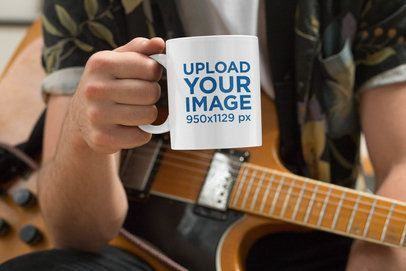 Placeit - Mockup of a Musician Holding an 11 oz Coffee Mug