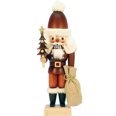 Christian Ulbricht Santa Holding A Christmas Tree and Presents Nutcracker - Santa Claus comes bearing gifts in this Christian Ulbricht Santa Holding A Christmas Tree and Presents Nutcracker . This wood nutcracker is an original.