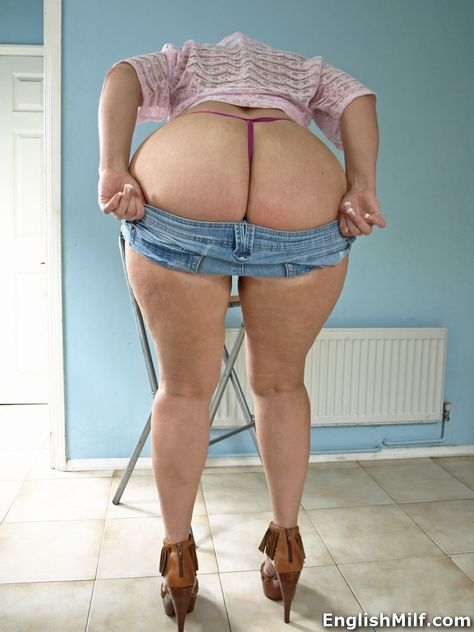 English MILF big butt British woman in heels removing her denim hot pants revealing her thong and ass.