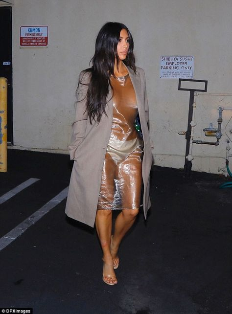 Kim Kardashian shows off bare chest in see through dress