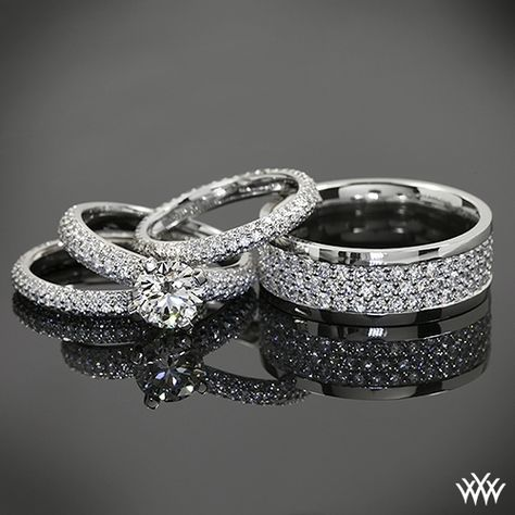 "Diamond dazzled by this powerful pave duo. Love men's bands that aren't afraid to rock a few ""ROCKS""!    Delightful Details   2 Lady's Platinum Full Eternity Wedding Bands  0.75ctw Bead-Set Whiteflash ACA diamond melee    Men's Platinum Full Eternity Wedding band  Approximately 2ctw Bead-Set Whiteflash ACA melee    Diamond Engagement Ring - 0.60ctw ACA melee  1.143 G SI1 Whiteflash ACA Hearts and Arrows Diamond"