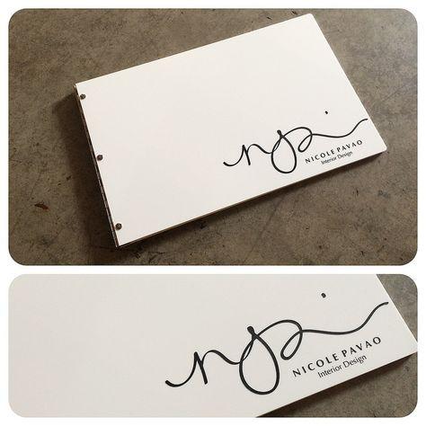 Custom interior design portfolio book in white acrylic with engraved color fill treatment   da KloPortfolios.com