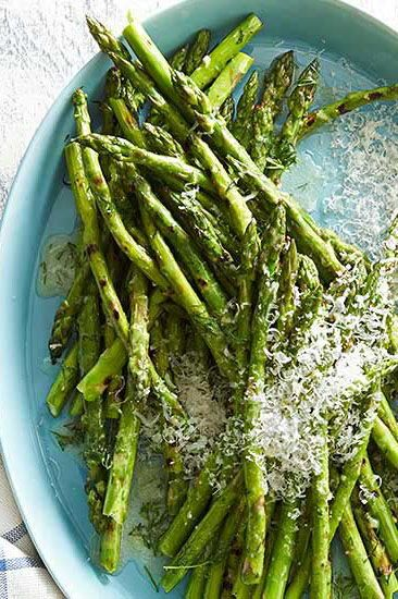 Memorial Day is the perfect time to work asparagus into your summer menu. Add fresh asparagus to the grill and top with melted butter and fresh dill. #memorialdayideas #memorialdayparty #sidedishideas #partysidedish #bhg