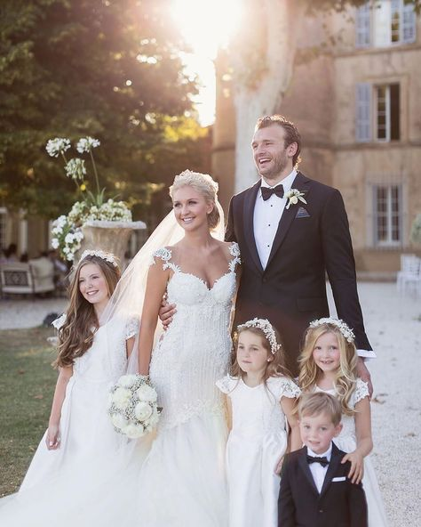 Picture perfect family - we just adore this wedding shot of #GLBride Ellie in her Galia Lahav #MsElle trumpet style wedding dress with her husband and flower girls.