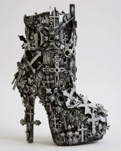 """These controversial """"Holy Mary"""" patent leather boots makes wearing your religion fashionable. Designed with hundreds of metal crucifixes, this platform boots has a platform height coupled with a heels"""