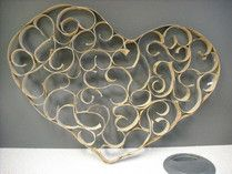Follow these simple instructions for making your own Faux Filigree Heart from cardboard tubes
