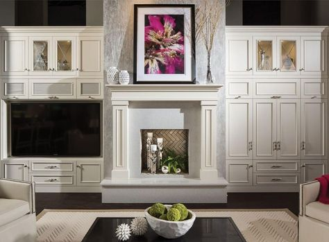 Entertainment centers have become a fashionable feature in new homes, and a popu... #cabinets #durasupreme #entertainmentcenter #entertainmentcenters #familyroomremodel #fireplace #fireplacedesign