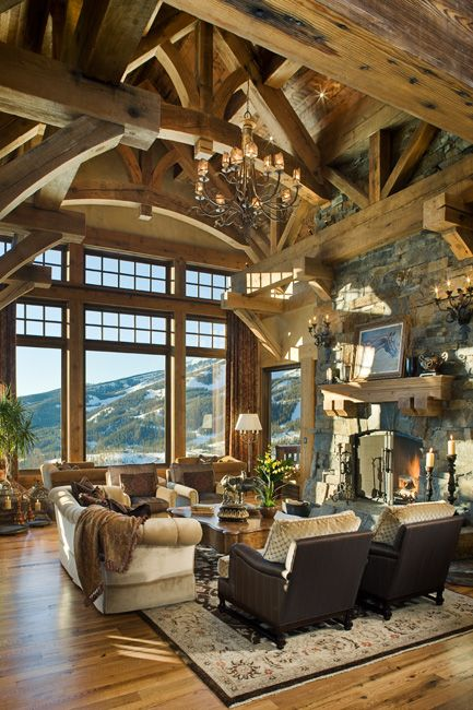 Open beam ceiling, wood flooring, amazing windows with a spectacular view, and comfy furniture for sitting in front of the fireplace.