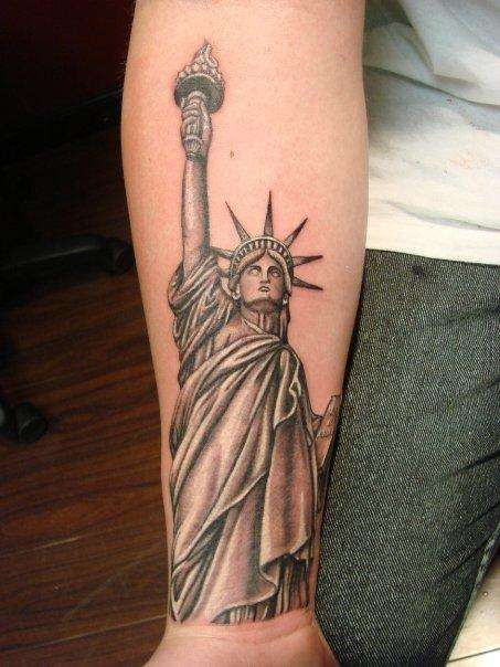 Black And Grey Statue Of Liberty Tattoo On Right Forearm
