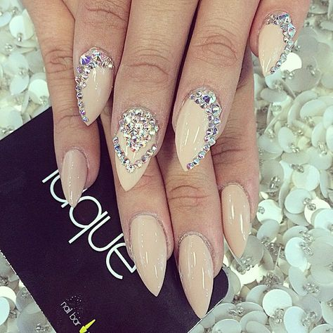 Nude stiletto nails with a touch of sparkle!
