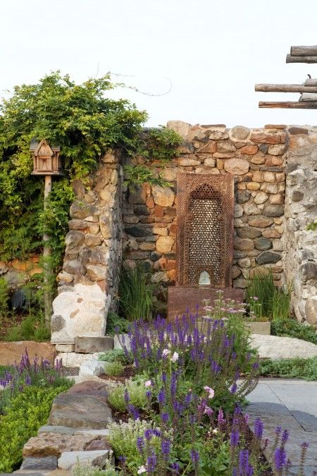 Purple plantings lead the way to a feature fountain | Photo Gallery: Gorgeous Gardens | House & Home