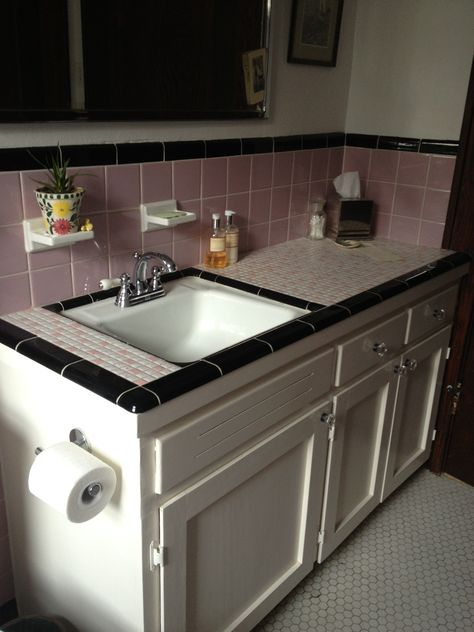 Before: pink and black tile, very 50s