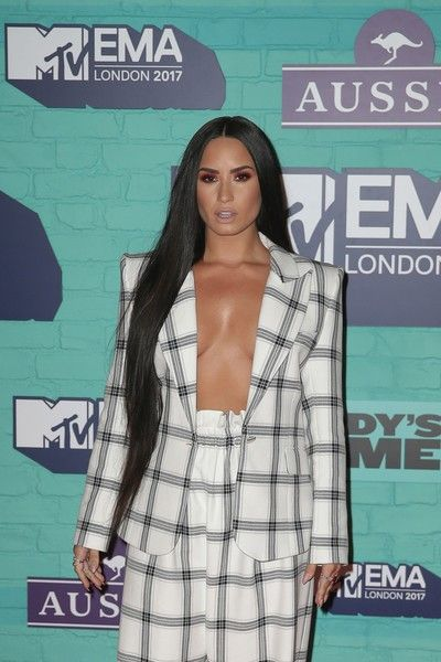US singer-songwriter Demi Lovato poses on the red carpet arriving to attend the 2017 MTV Europe Music Awards (EMA).