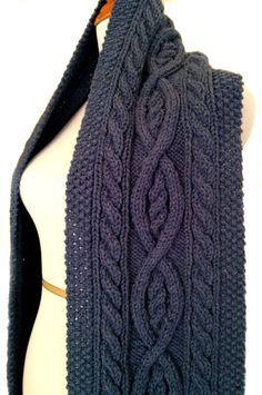 PDF Knitting Pattern for the Killarney Cable Knit Scarf by Sharondipity Designs! Classic Cable Knit Scarf handcrafted in the traditional Irish twisted cable knit style! Feel free to wrap it around as many times as you like thanks to the generous size and long length. Scarf measures 8 wide by 70 long with an additional 5 of fringe on each end. 100% Acrylic Worsted Weight Yarn or yarn of your choice but worsted weight works best! 100% machine washable (on gentle cycle, of course!) and dryer...