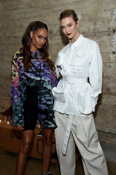 Joan Smalls (L) and Karlie Kloss attend the Louis Vuitton Dinner Mens SS19 Temporary Residency.