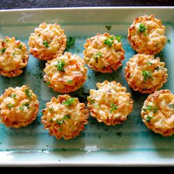 "King Crab Appetizers | ""These crab tartlets have long since been a family favorite and are requested often at holiday get togethers."""