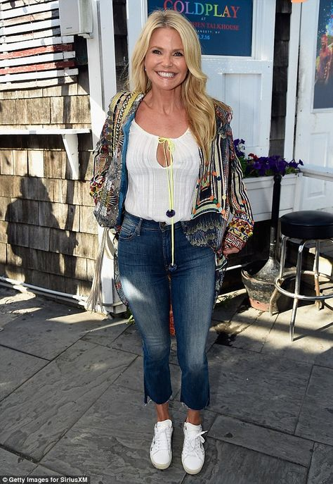Keeping busy: Christie showed off a smile as she was spotted at Coldplay's performance for...