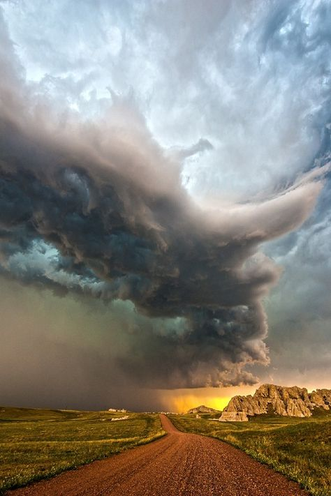 ponderation:  Van Tassel, Wyoming by tornadochaser06 Outflow dominant storm with some cool rock formations on the Woming/Nebraska border on June 24, 2012.