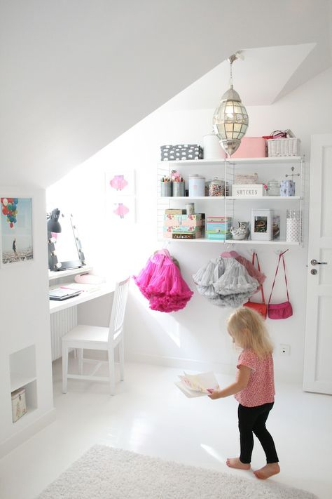 kids room..fantastic shelves above pegs.  would be great to wallpaper behind just this area, perhaps a four foot section.