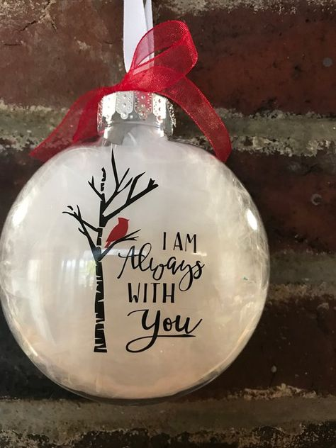 """CHRISTMAS ORDERS MUST BY PLACED BY DECEMBER 10 , I can't guarantee delivery after that ❤️ plastic disc shaped ornaments, filled with white feathers , 1 has just a red cardinal the other one says """"I am always with you """" with a cardinal in a tree . These are made with permanent"""