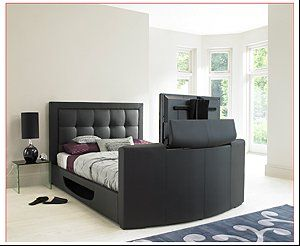 Ultimate luxury - a bed with TV included! The TV can be hidden away in the  foot-end of the bed when not required! http://www.ukhomeideas.co.uk/ide