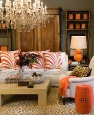 Apricot... a softer orange that looks fabulous in this room with dull gray/taupe walls