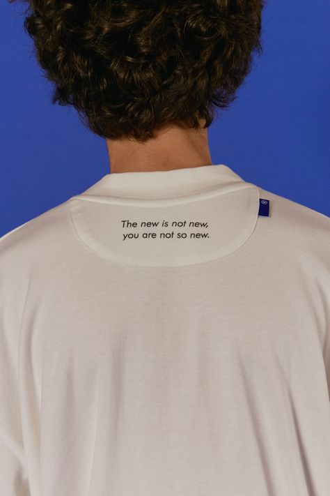 Interesting fabric tag placement on neckline