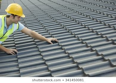 Builder Working On Roof Of New Building Roof Inspection Roof Repair Best Roofing Company