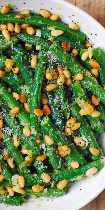 Green Beans with Pine Nuts is an easy and healthy recipe that will make a great side dish for any main course!  It's a perfect and delicious way to add something green and healthy for your dinner! #greenbeans #salad #pinenuts #healthysalad