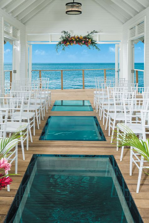 Yep, you can now marry here! Perched over the crystal clear waters of the Caribbean Sea is the Serenity Chapel at Sandals Ochi Beach Resort in Jamaica. Destination wedding ideas don't get more… Jamaica Wedding, Wedding Venues Beach, Destination Wedding Locations, Beach Wedding Decorations, Chapel Wedding, Wedding Ceremonies, Water Theme Wedding, Weddings Abroad Destinations, All Inclusive Wedding Packages