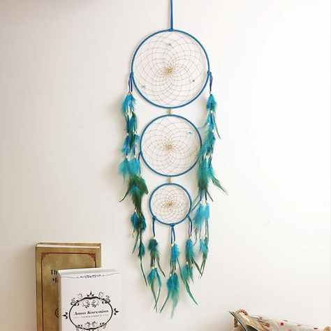 Exquisite hand-made dreamcatchers... for all your dreams. Dreamcatcher or Dream Catcher: In some Native American cultures a dreamcatcher is a handmade object based on a willow hoop, on which is woven a loose net or web. The nightmares will pass through the holes and out through the window. The good and beautiful dreams are trapped in the web and slide down the feathers to the sleeping person. Now wake up and chase those dreams! Features: Size: about 70 cm / 27 in We ship securely with a tracking