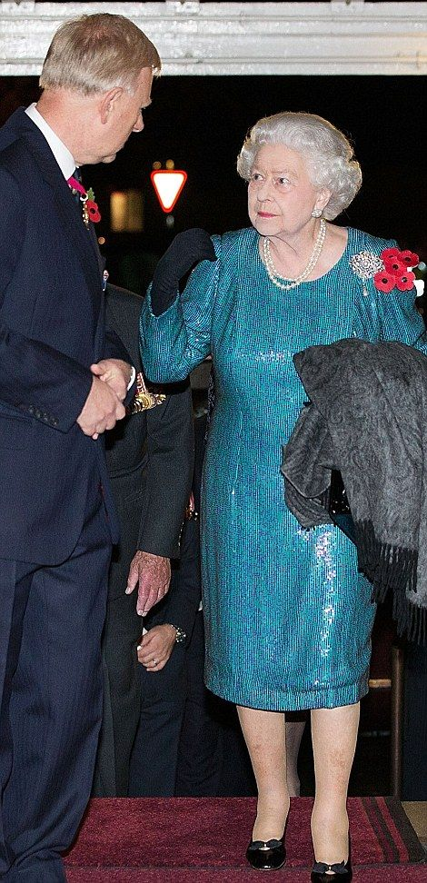 The Queen arrives at the Royal Albert Hall ~~ 8 November 2014 for the Festival of Remembrance which will be broadcast on BBC
