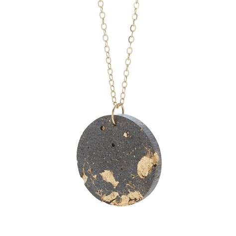 Concrete and gold make a unique pair in Lisa and Sean Reico's handmade necklace.