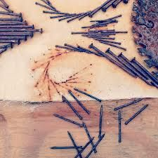 rust dyed textile - Little Seed Farm make patterns with the nails to create a print.