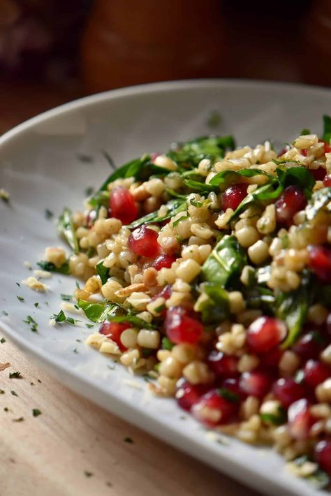 Create the best Spinach Salad with fregola Sarda and pomegranate arils. This healthy, refreshing and tasty winter salad makes a great side! #spinachsalad