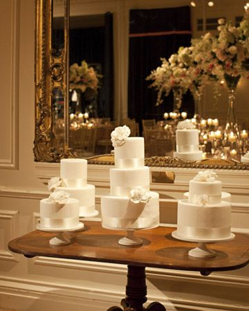 I like the idea of having a mini wedding cake as the centerpiece for each table.  But super expensive.  Fun to think about.  And I just like decorated cakes.