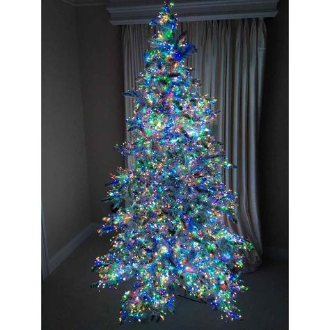 The Stars In The Sky Pre Lit Christmas Tree With Multicolor Lights Hanging Christmas Lights Pre Lit Christmas Tree Christmas Lights