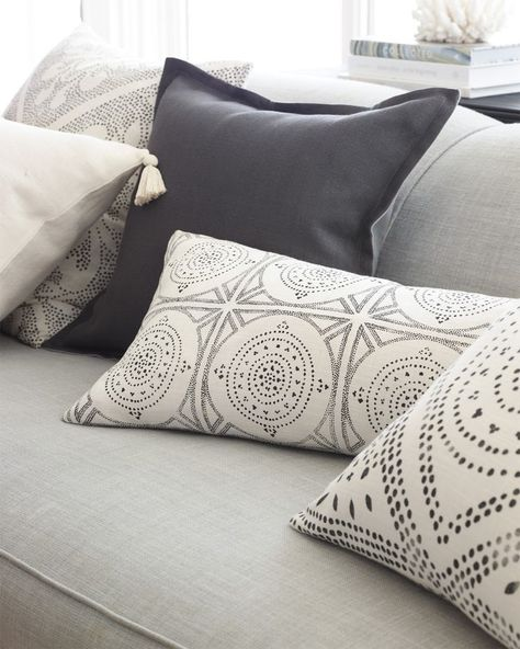 These neutral gray and ivory toned throw pillows are perfect for a contemporary living room.