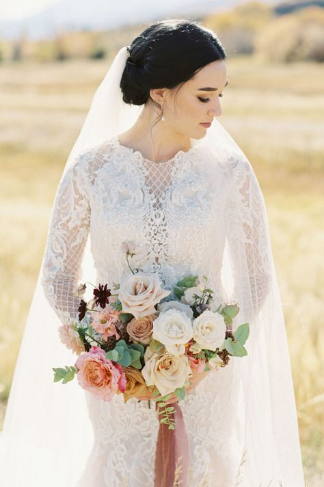 From the editorial Think Ranch Wedding Venues Are Too Rustic? Think Again. From the bride's long sleeved beaded gown to the gorgeous mountain ranch views, everything about both this ceremony and reception will leave you absolutely speechless. 😍  Photography: @sophiekayephotography  #beadedweddingdress #longsleeveweddingdress #bridedress #weddinggown #fallweddingdress