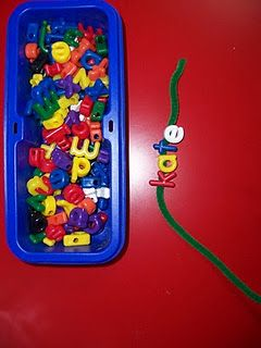 letter beads to spell their classmates names on a pipe cleane