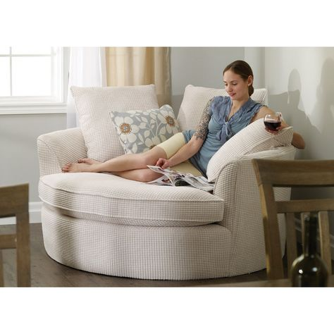 Perfect in corners, this oversized round nest chair features ample cushions, two�