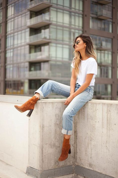 White tee high waisted jeans and tan booties Street style street fashion best street style OOTD OOTD Inspo street style stalking outfit ideas what to wear now Fashion Blo.
